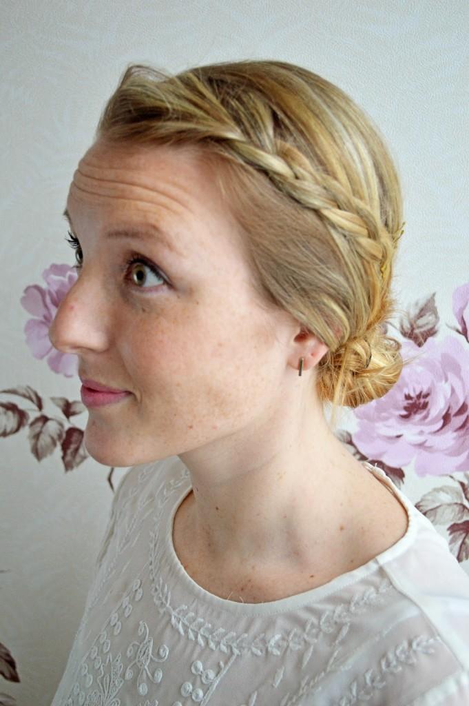 side braid low bun hairstyle