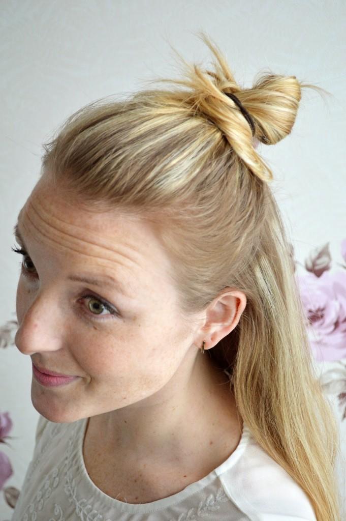 half up half down bun hairstyle