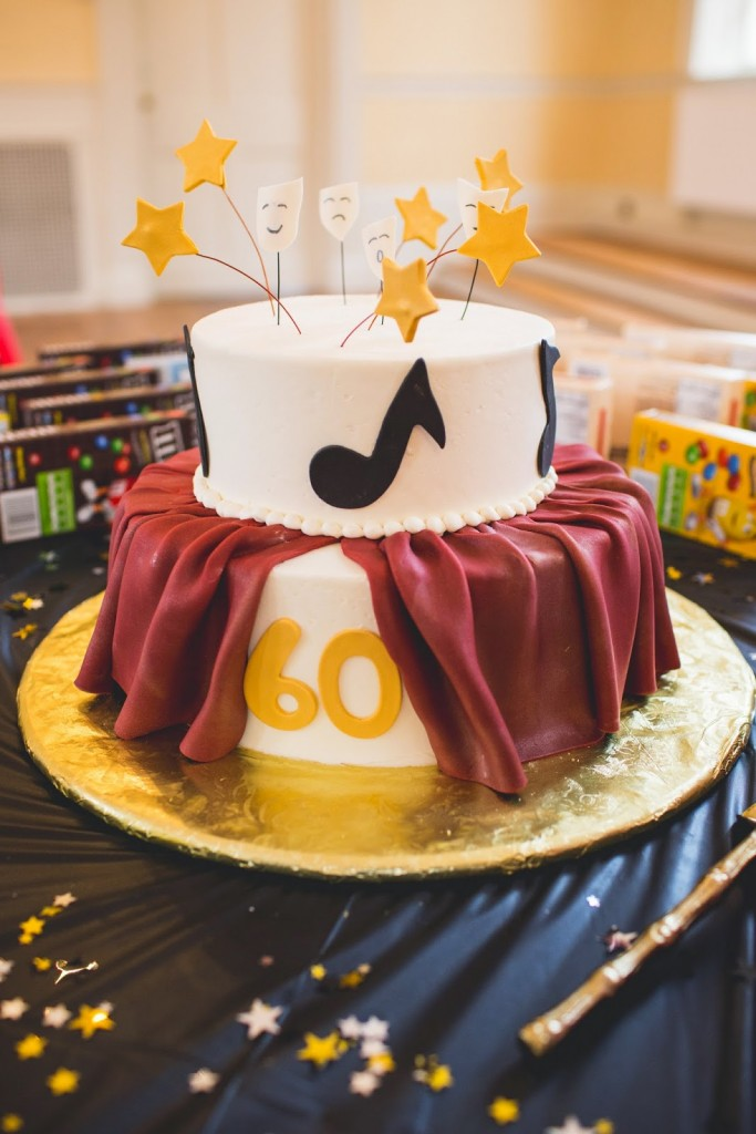 musical notes and theater curtain fondant cake