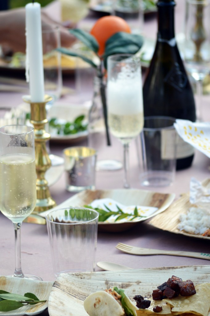 champagne bottles in outdoor party tablescape