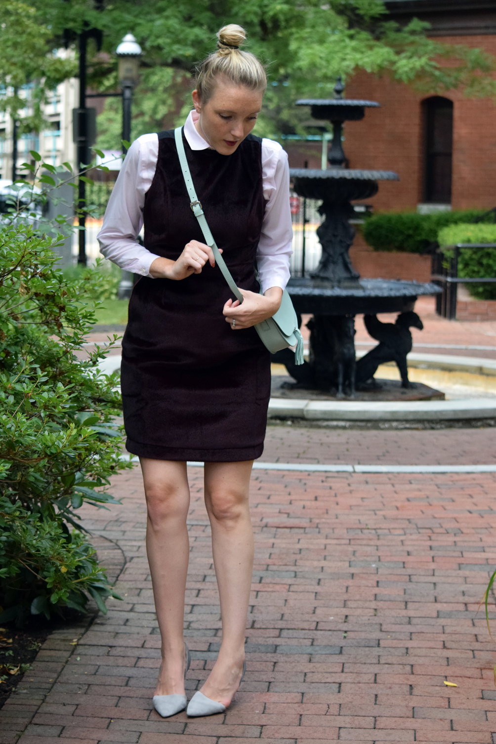 faux fur dress layered over vintage blouse with cross body bag