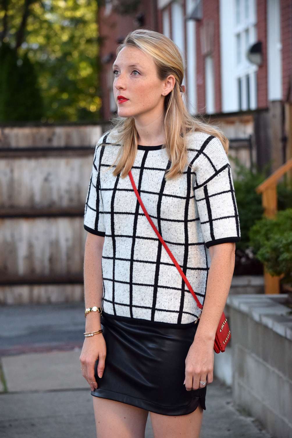 little leather skirt and checked sweater