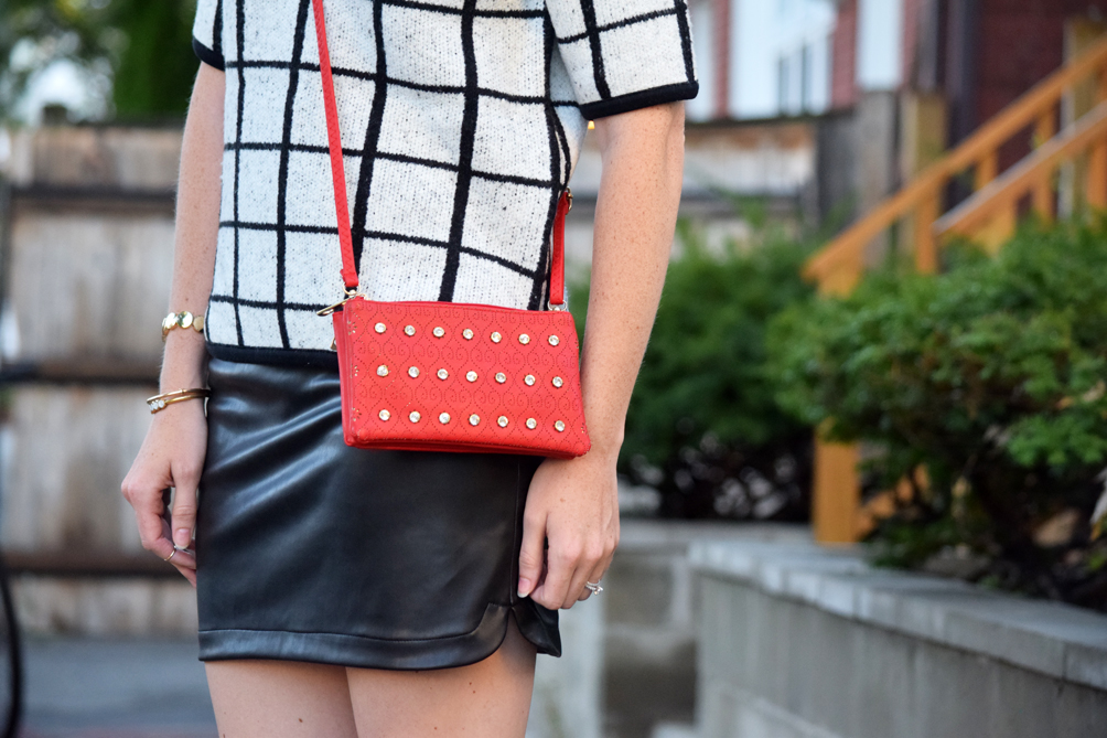 leather mini skirt with red crossbody bag