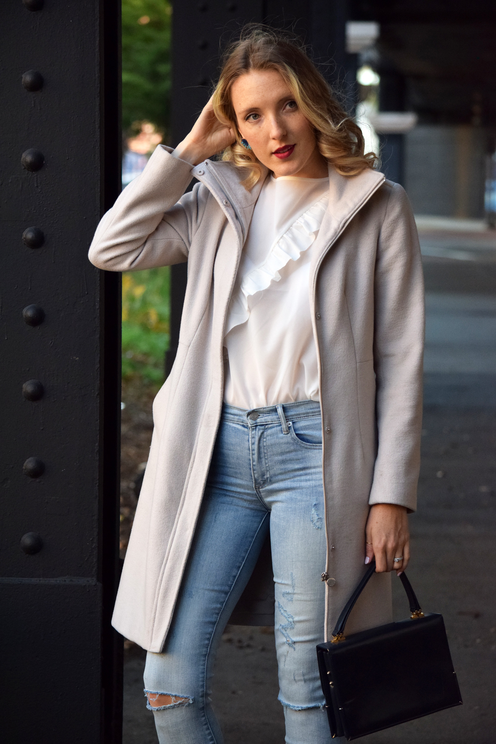ruffled top with high waisted jeans