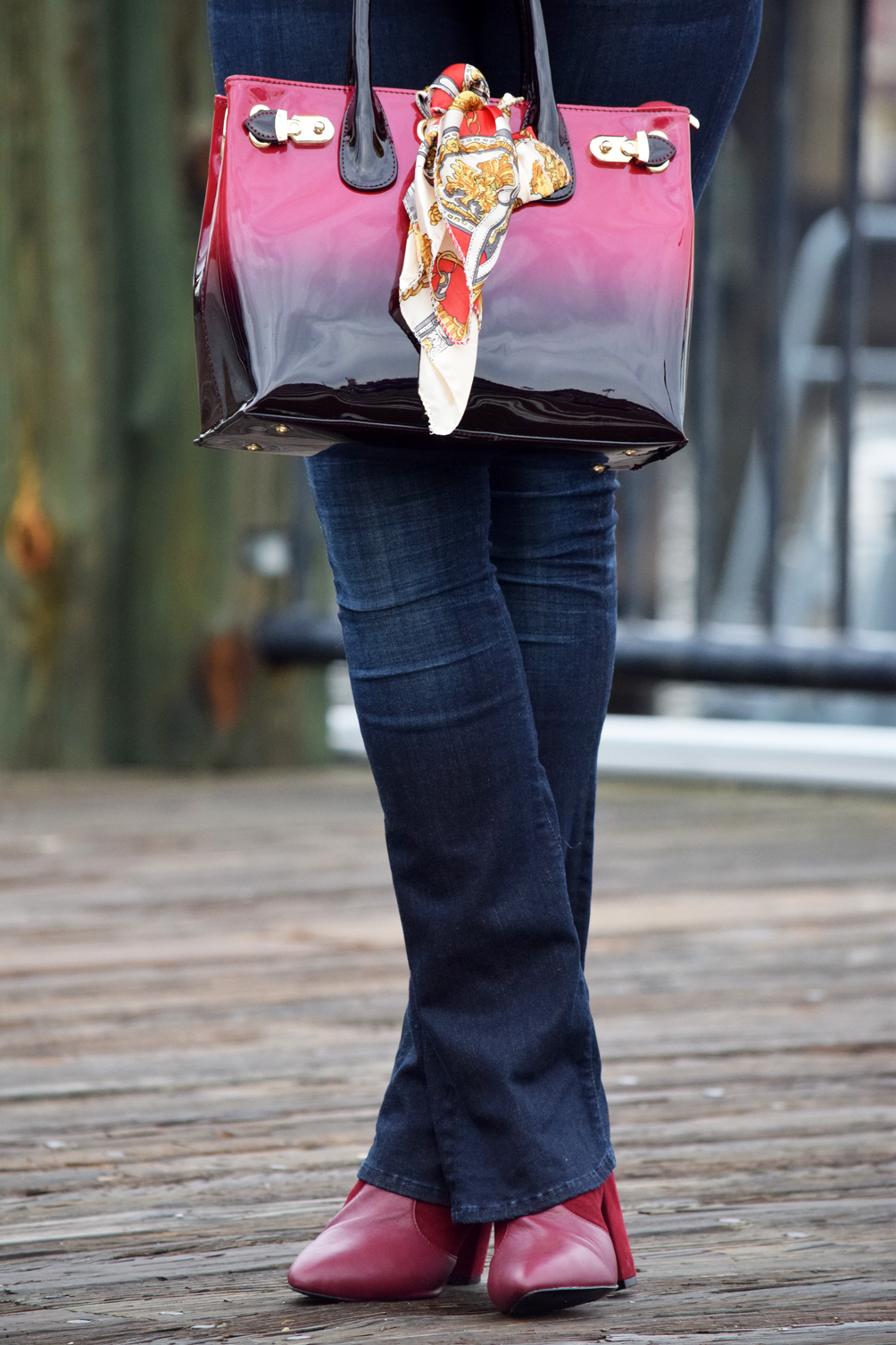 burgundy ankle boots and red ombre bag