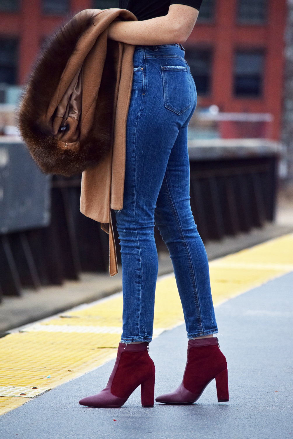distressed skinny jeans with oxblood ankle boots