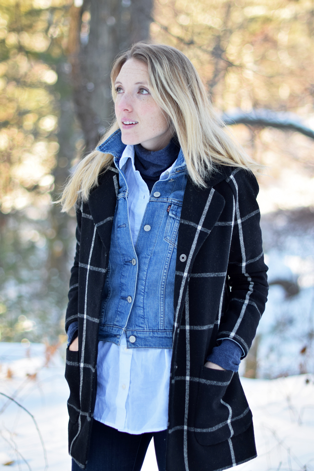 layered turtleneck with a button-down shirt, jean jacket, checked coat
