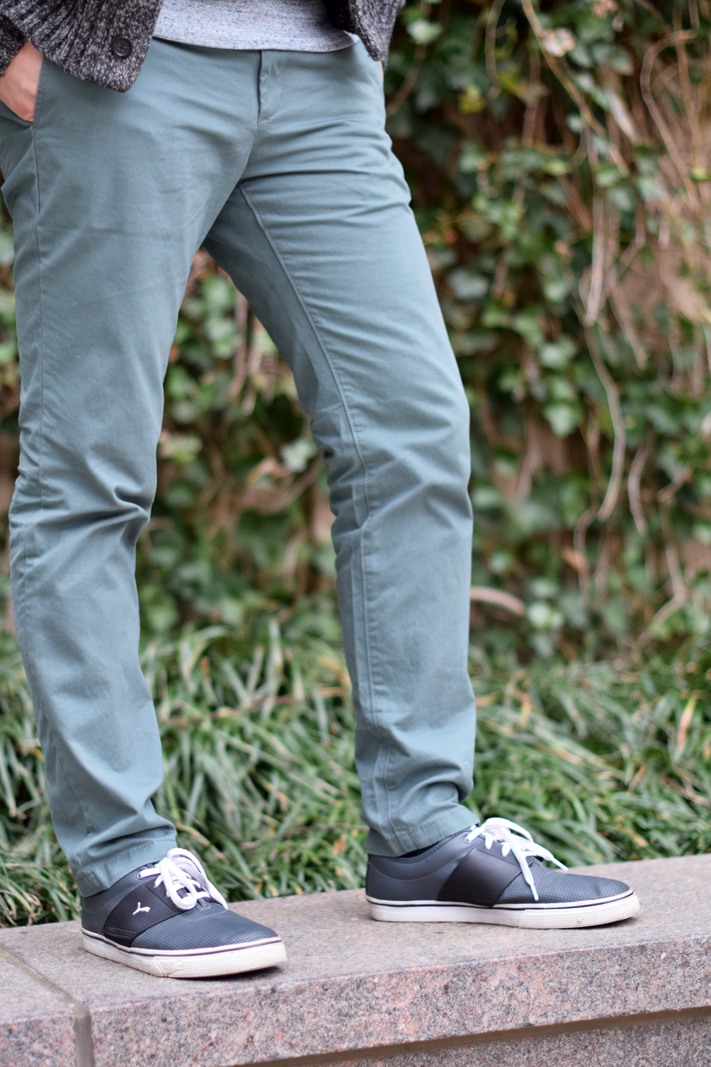 men's green chino pants and Puma sneakers - one brass fox