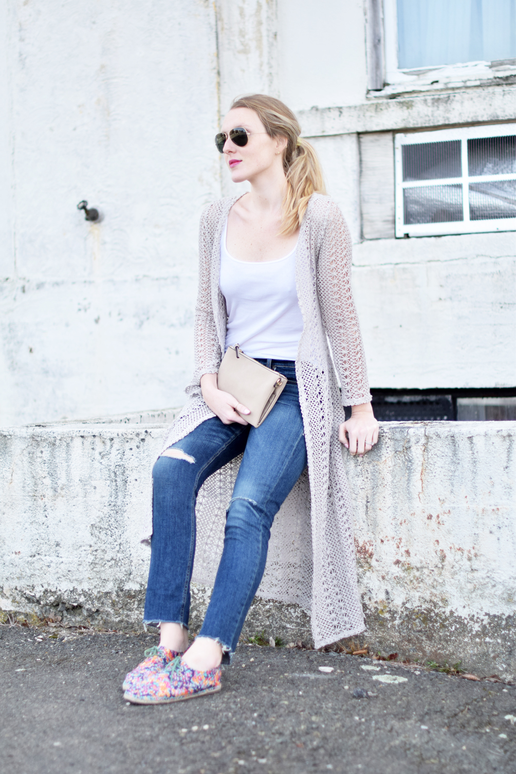 casual spring style outfit with ribbed jeans, a crochet duster, and floral espadrilles - one brass fox