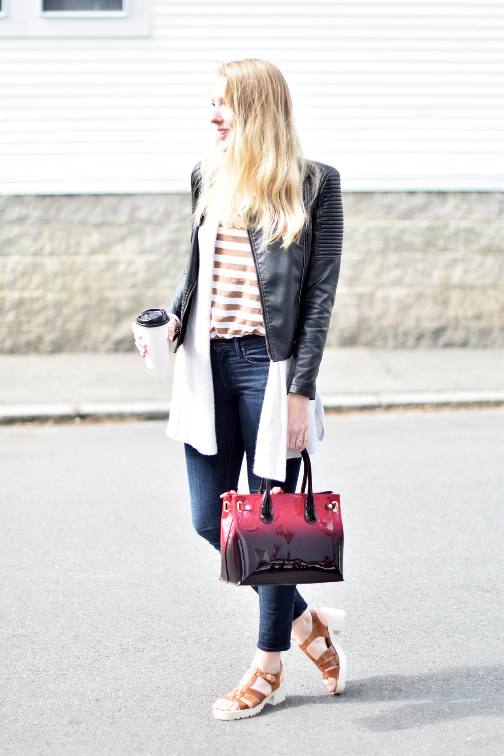moto jacket with a striped tee, skinny jeans, and clog sandals - one brass fox