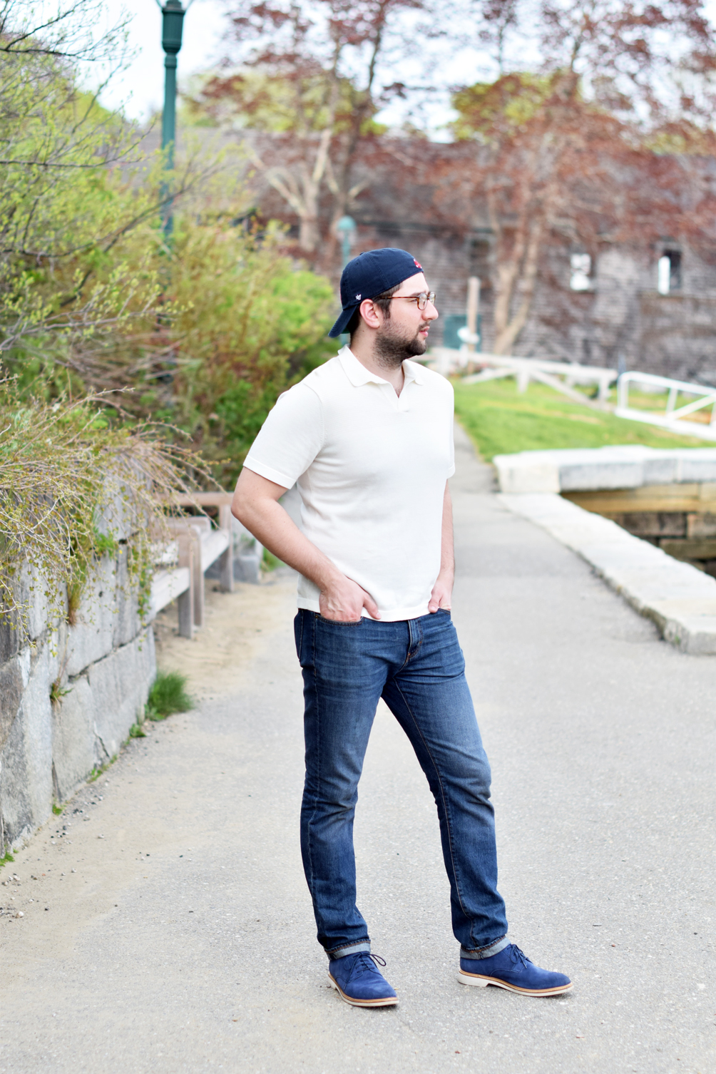 a gentle(man) friday, sweater polo with jeans, suede loafers, and a backwards baseball cap - one brass fox
