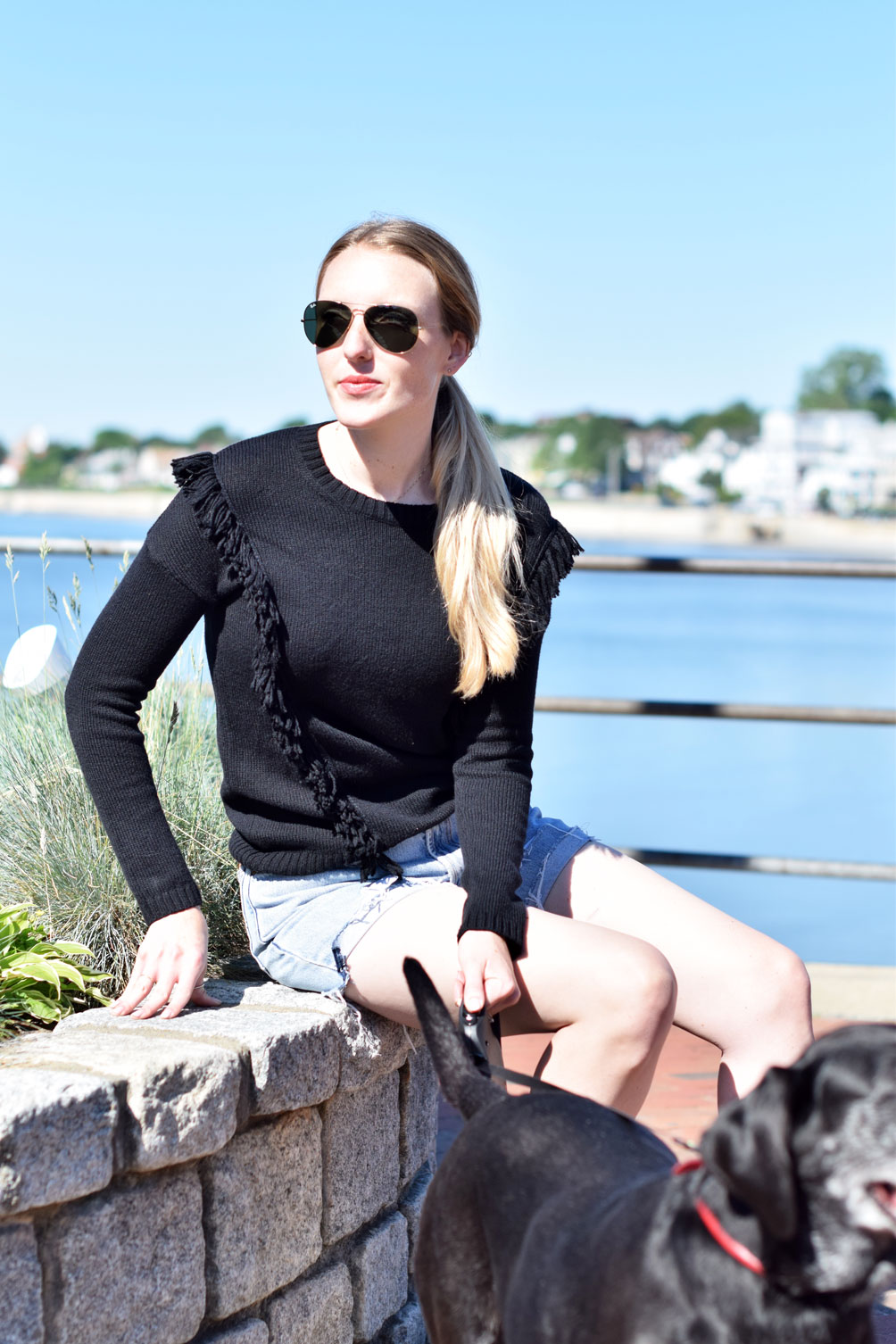 summer style from Leslie Musser of one brass fox wearing a fringe crewneck sweater with cutoff shorts and platform sneakers