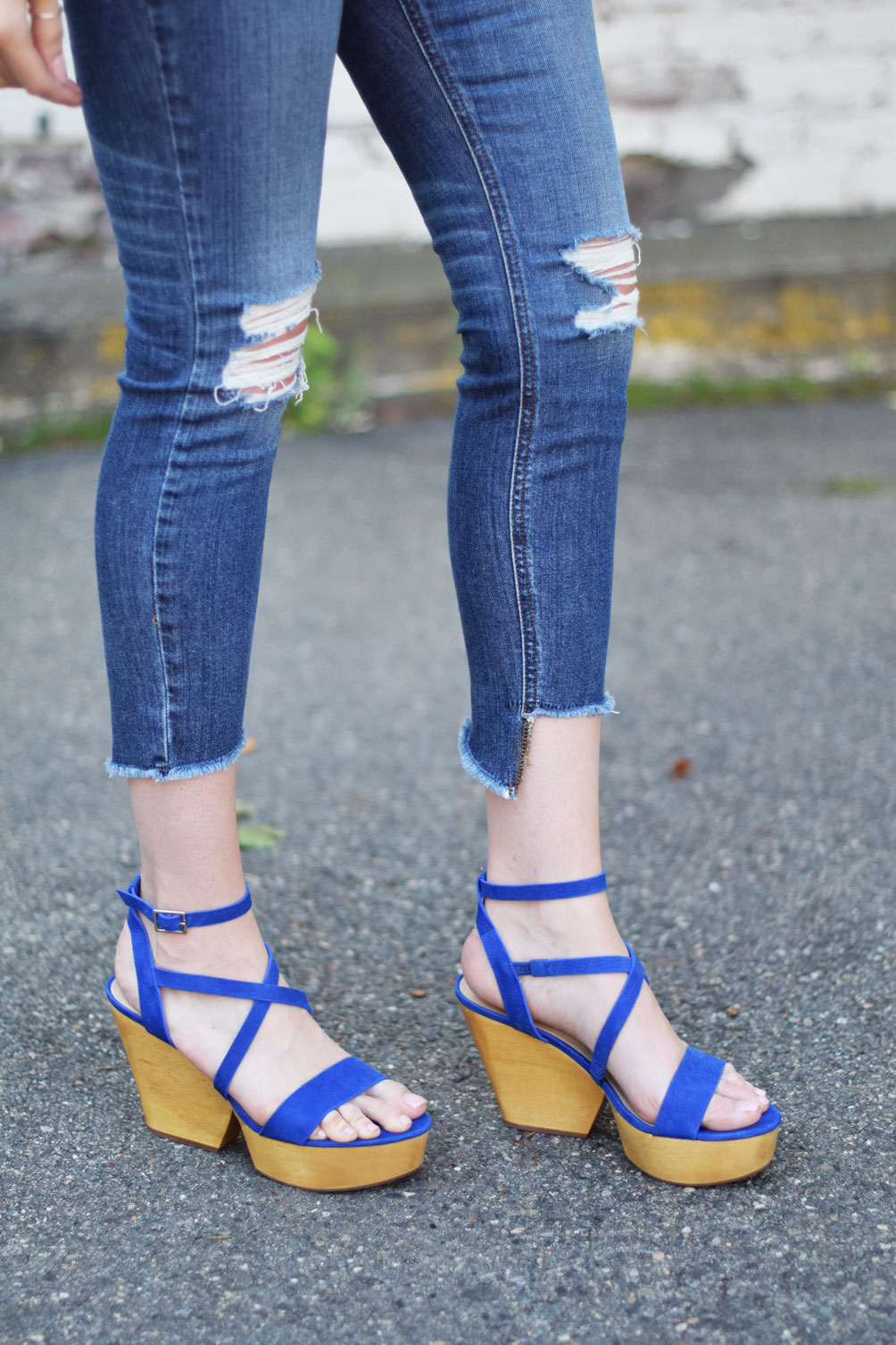 leather platform sandals with raw edge denim and an oversized tee from Leslie Musser of one brass fox