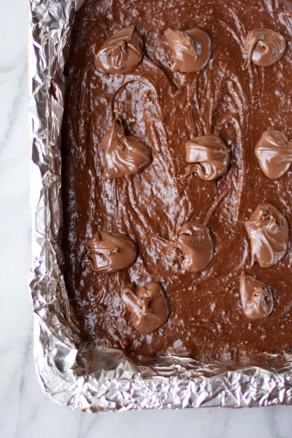 salted caramel nutella brownies are an easy and decadent chocolate dessert recipe from Leslie Musser of one brass fox