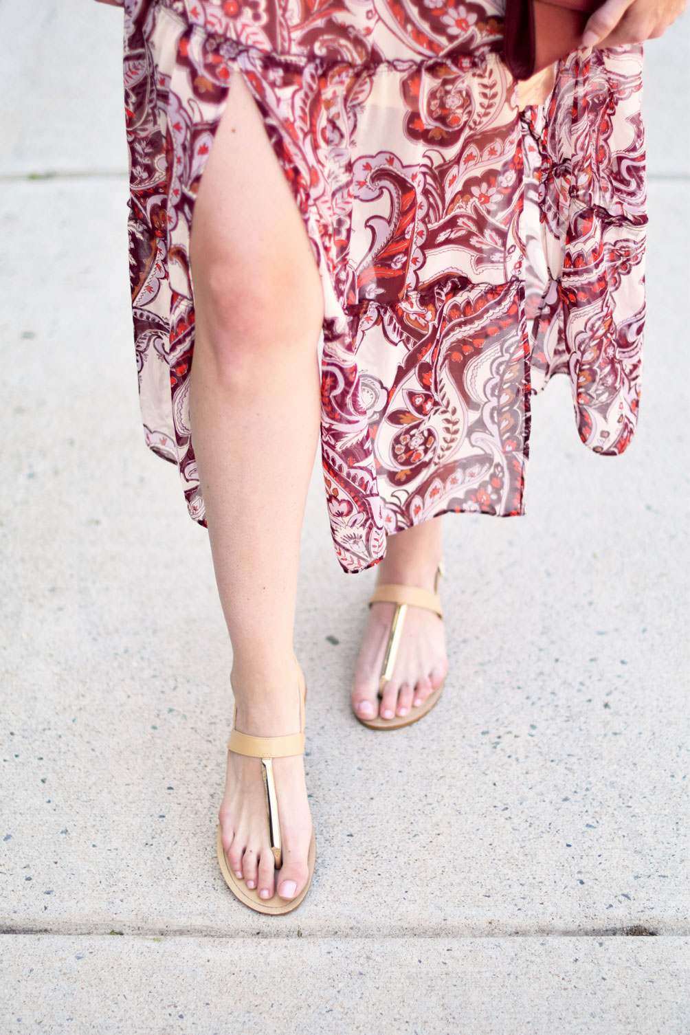 tie neck peasant midi dress with an oxblood clutch and simply top knot on Leslie Musser of one brass fox