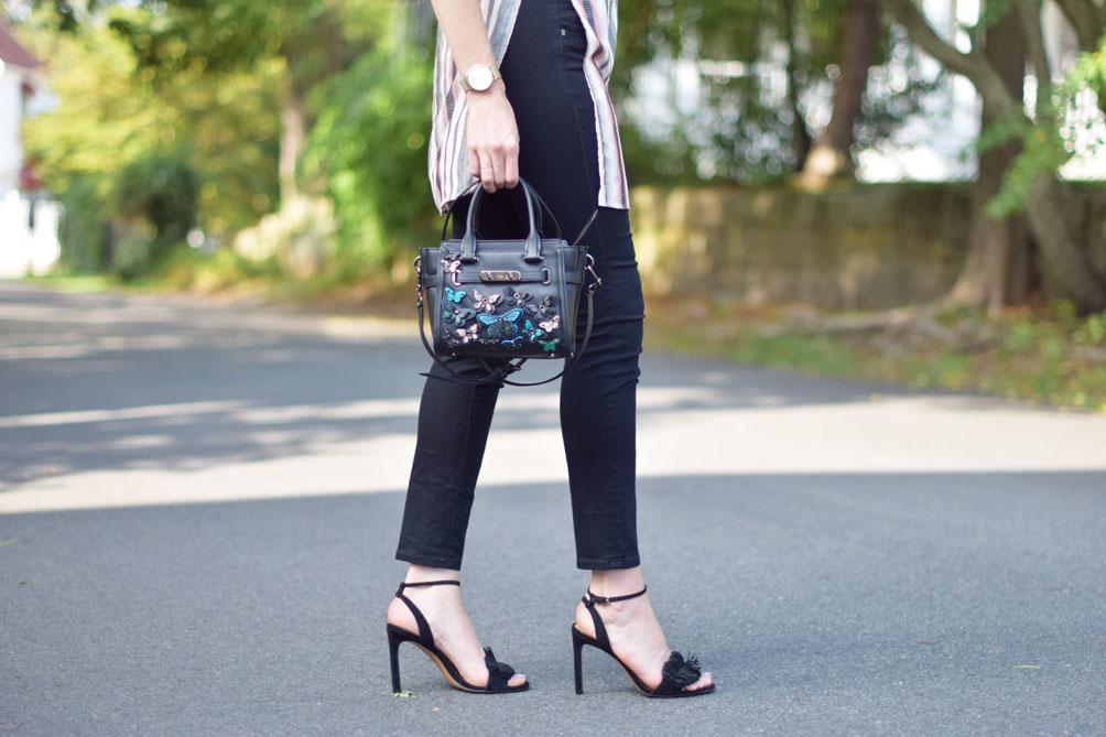 butterfly embellished Coach bag with fringe sandals on Leslie Musser of one brass fox