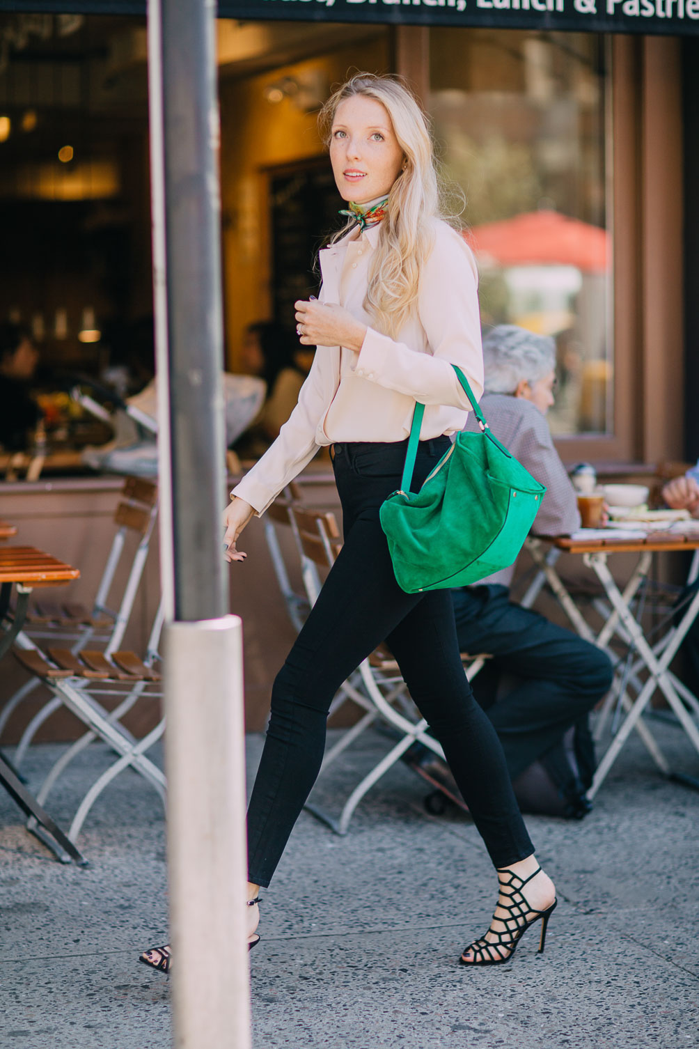 rose quartz silk blouse with jet black skinny jeans and an emerald bag on Leslie Musser one brass fox