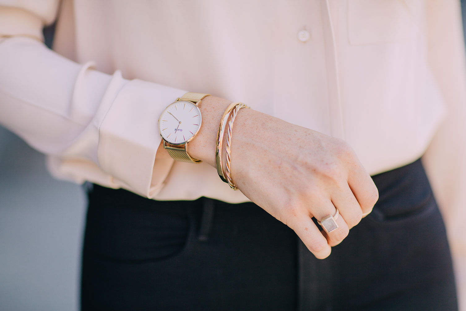 Cluse watch and minimal gold jewelry on Leslie Musser one brass fox