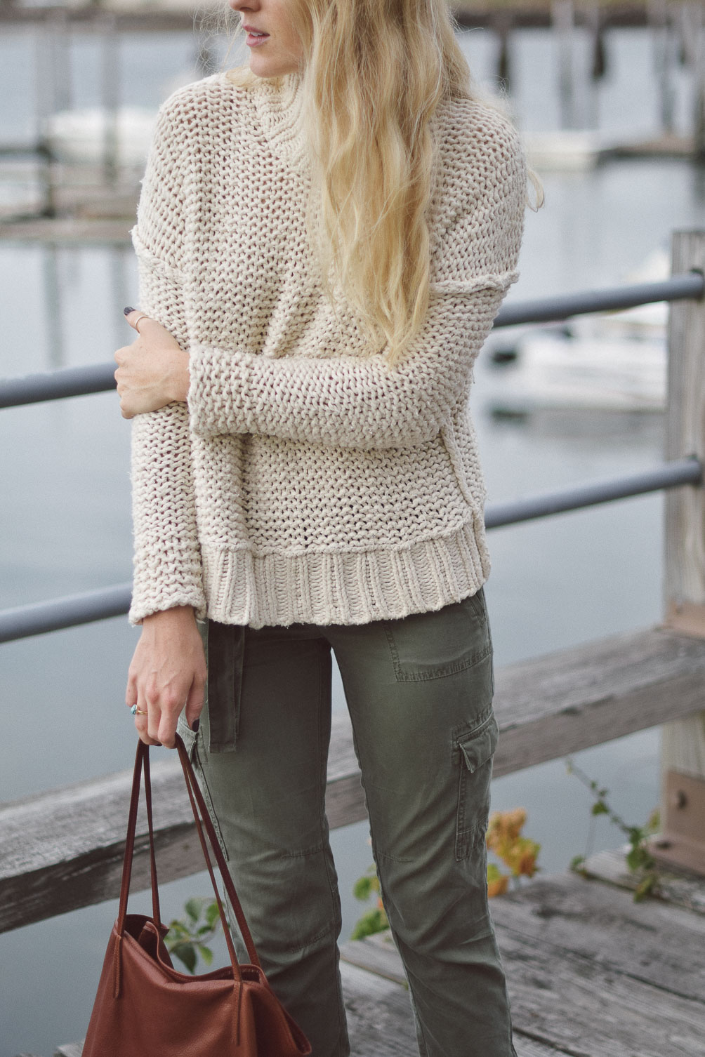 Free People chunky knit sweater with AG cargo pants on Leslie Musser one brass fox