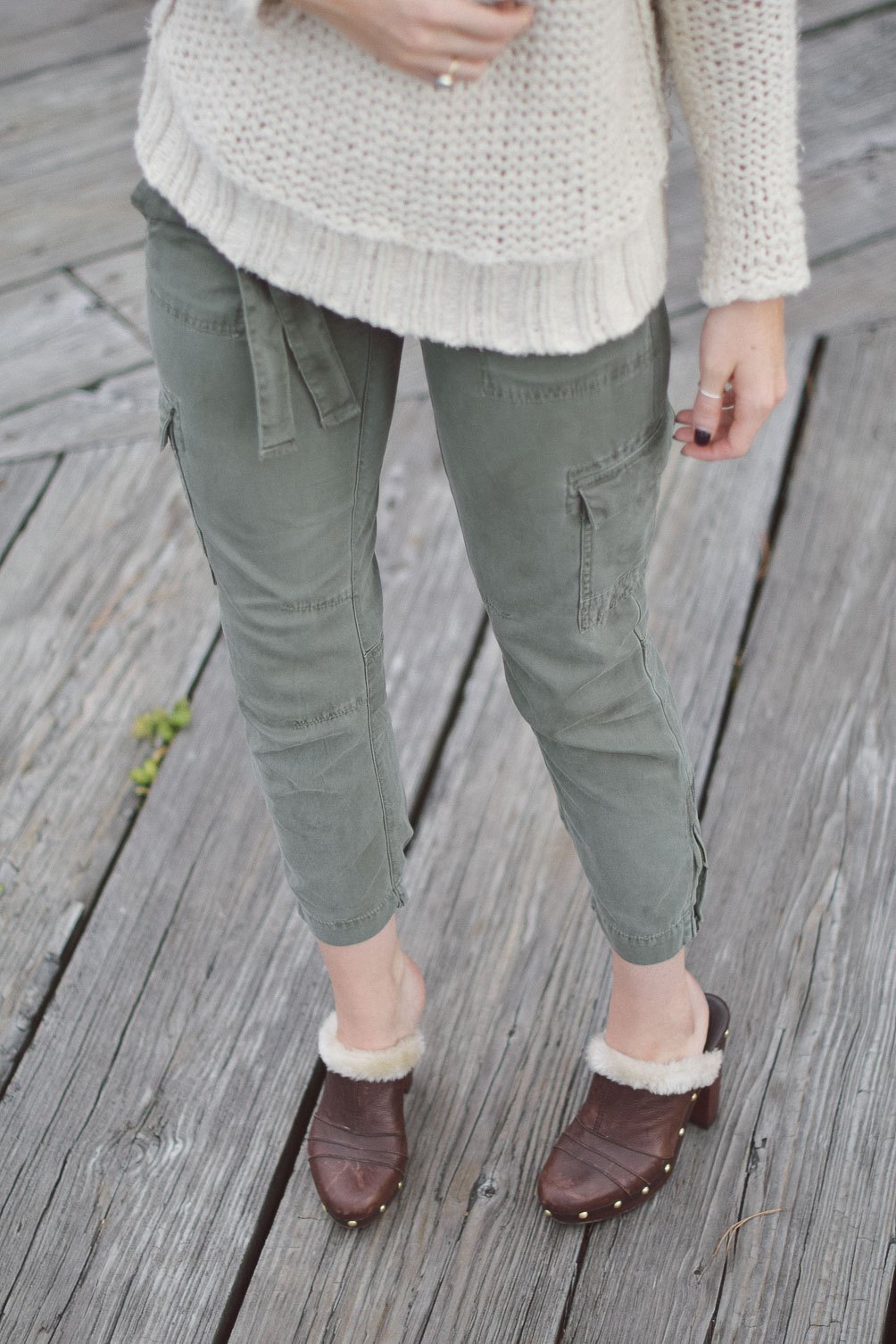 AG cargo pants and faux fur clogs on Leslie Musser one brass fox
