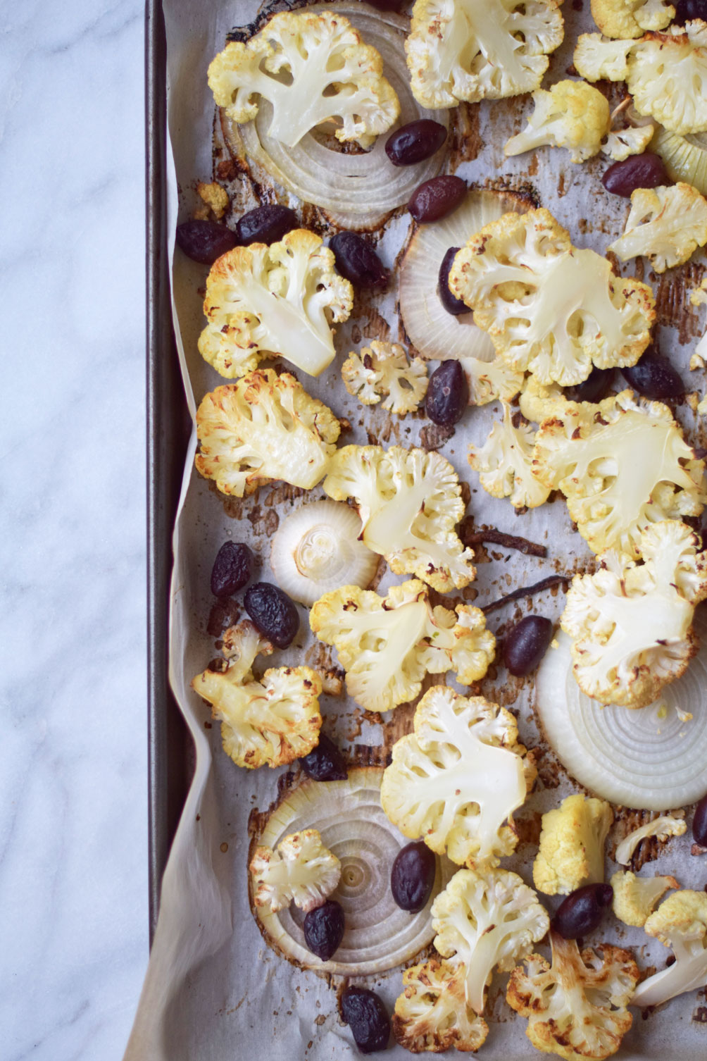 sweet and savory fall recipe for roasted cauliflower with fig + olive from lifestyle blogger Leslie Musser, one brass fox