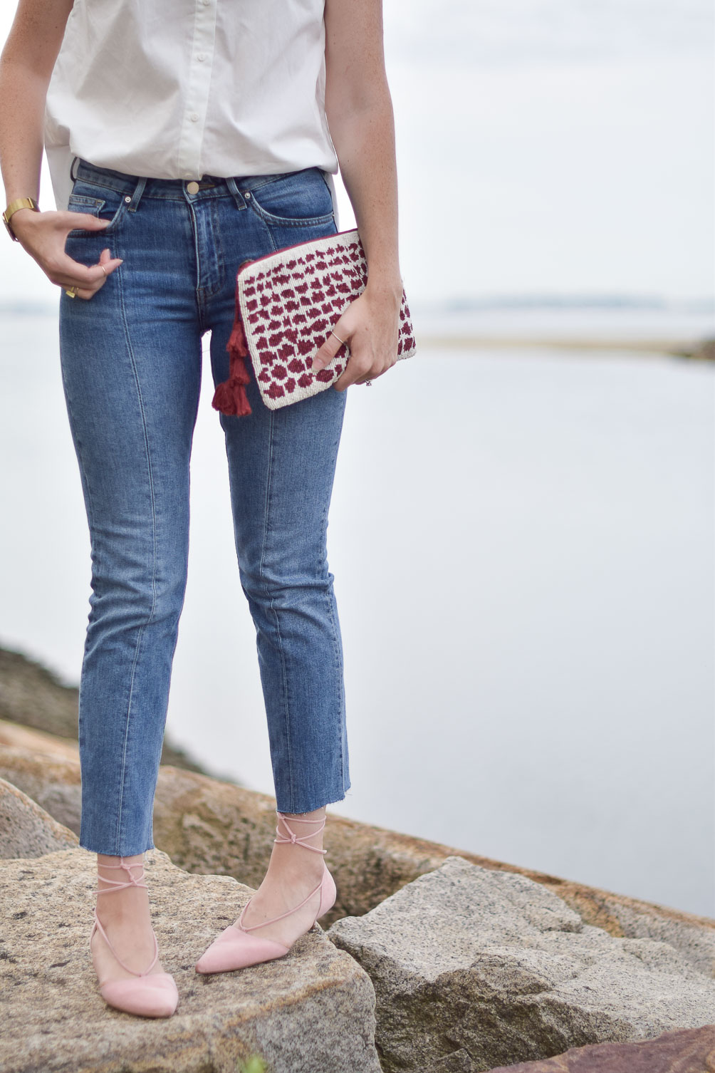 ruffled cotton blouse with crop jeans, blush kitten heels, and a beaded clutch on one brass fox