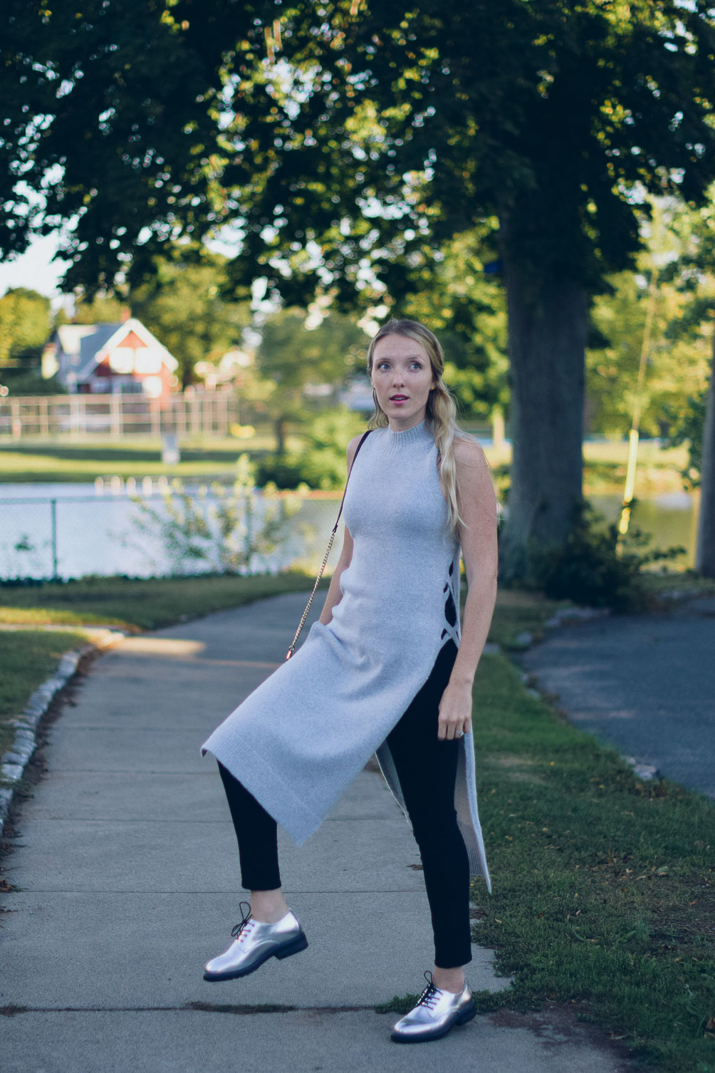 Leslie Musser turtleneck side split tunic with black skinny jeans and metallic oxfords on one brass fox