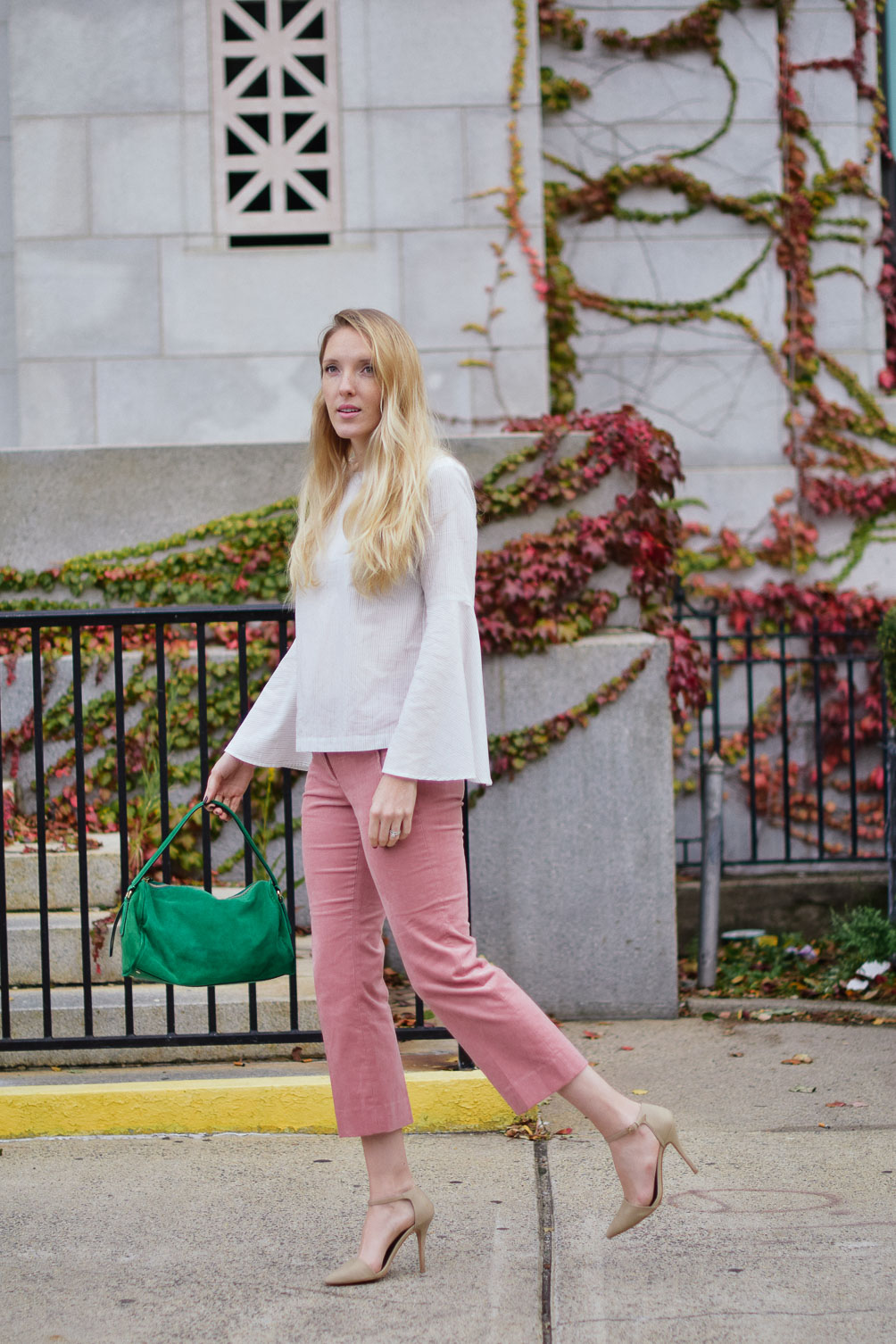 478ad0be4657 Leslie Musser wears cropped blush corduroys with a striped bell sleeve top  and emerald tote on