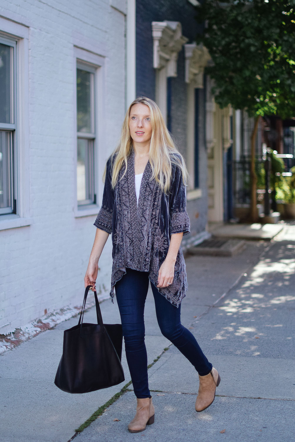 Leslie Musser embroidered velvet jacket and dark skinny jeans with ankle boots fall outfit inspiration on one brass fox