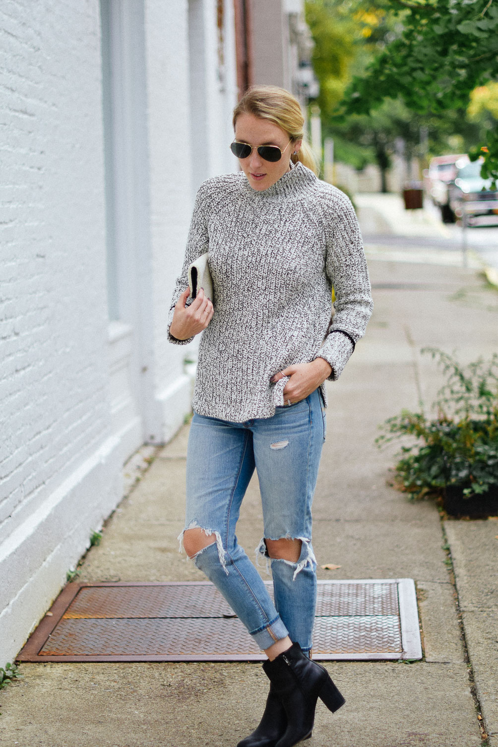 Leslie Musser cozy fall outfit with Topshop funnel neck sweater and American Eagle ripped jeans one brass fox