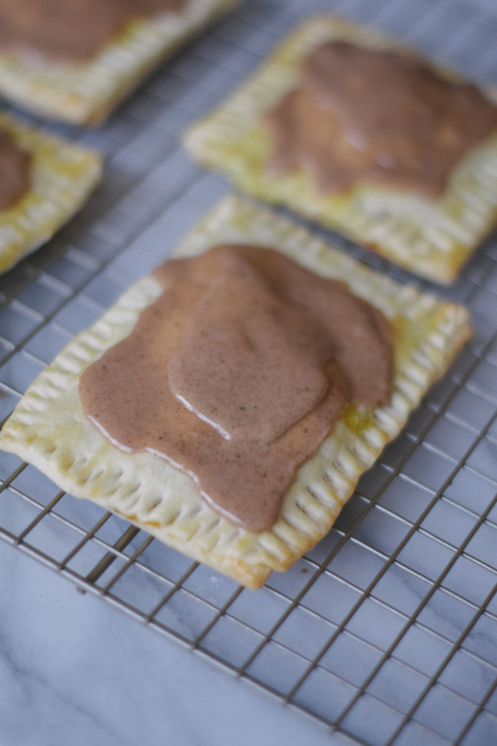 easy and delicious fall recipe for pumpkin brown sugar pop tarts on one brass fox