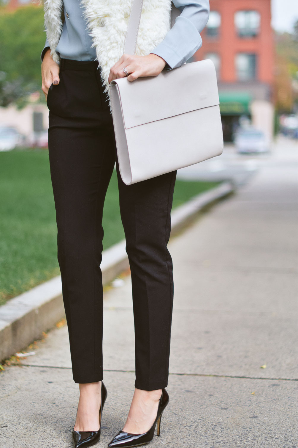 Leslie Musser fall work wardrobe outfit ideas with Johhny Was shearling vest, Primark tuxedo pants, Kate Spade patent pumps on one brass fox