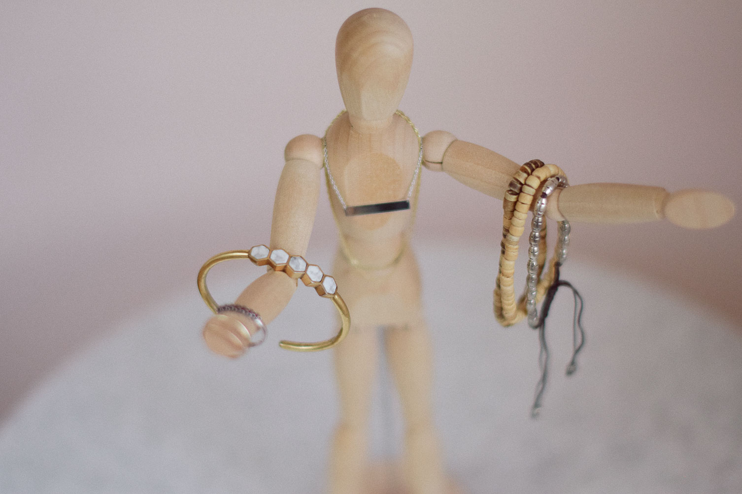 sharing tips on how to wear mixed metal jewelry with bracelets, necklaces, and rings