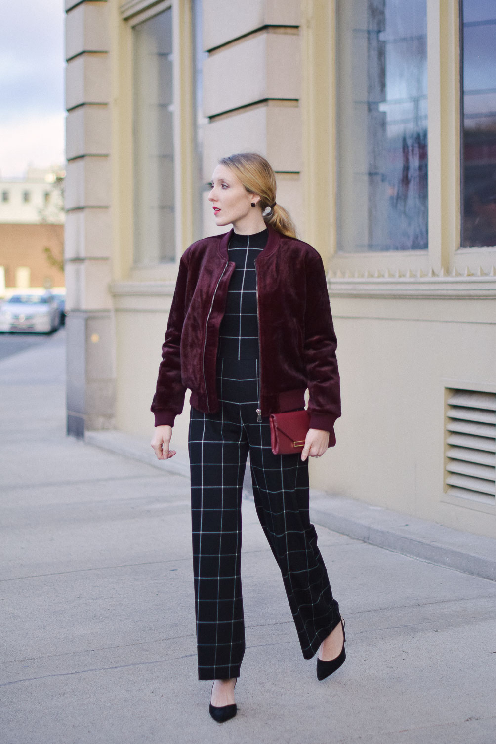 styling a check jumpsuit with faux fur bomber jacket for alternative holiday party outfit ideas
