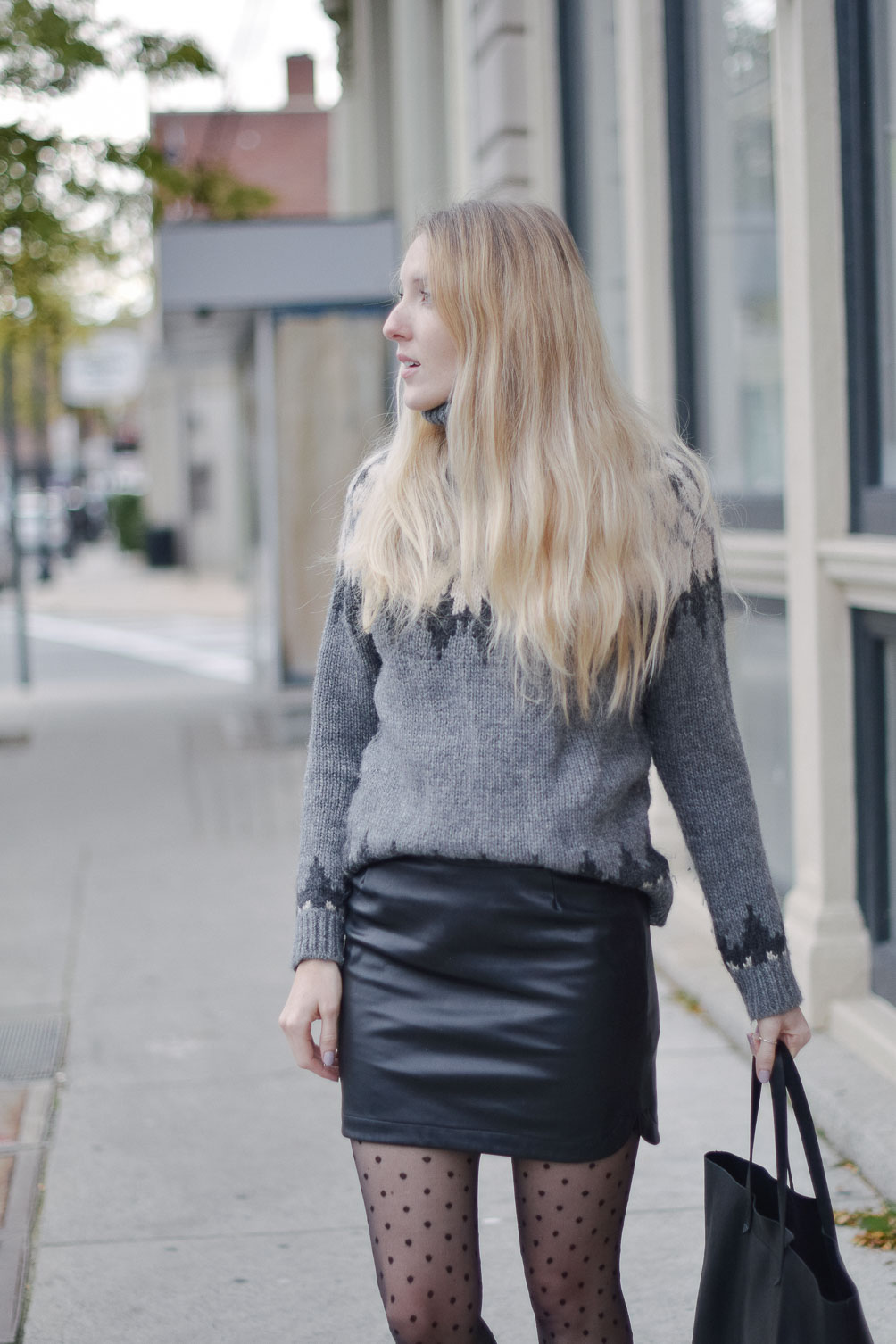 fashion blogger Leslie Musser wearing a cozy winter date night outfit