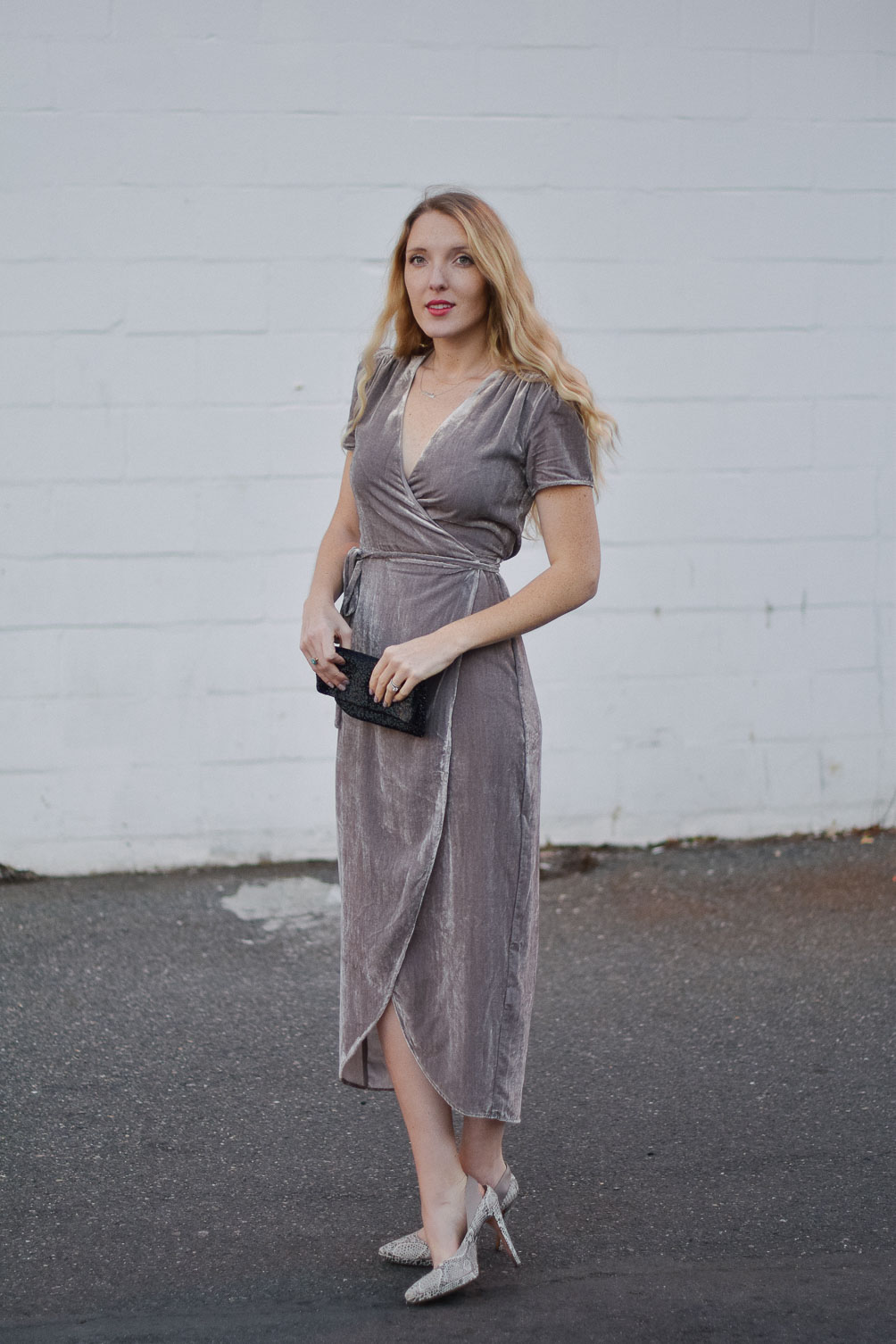 styling a metallic holiday dress party outfit with snakeskin heels and beaded clutch