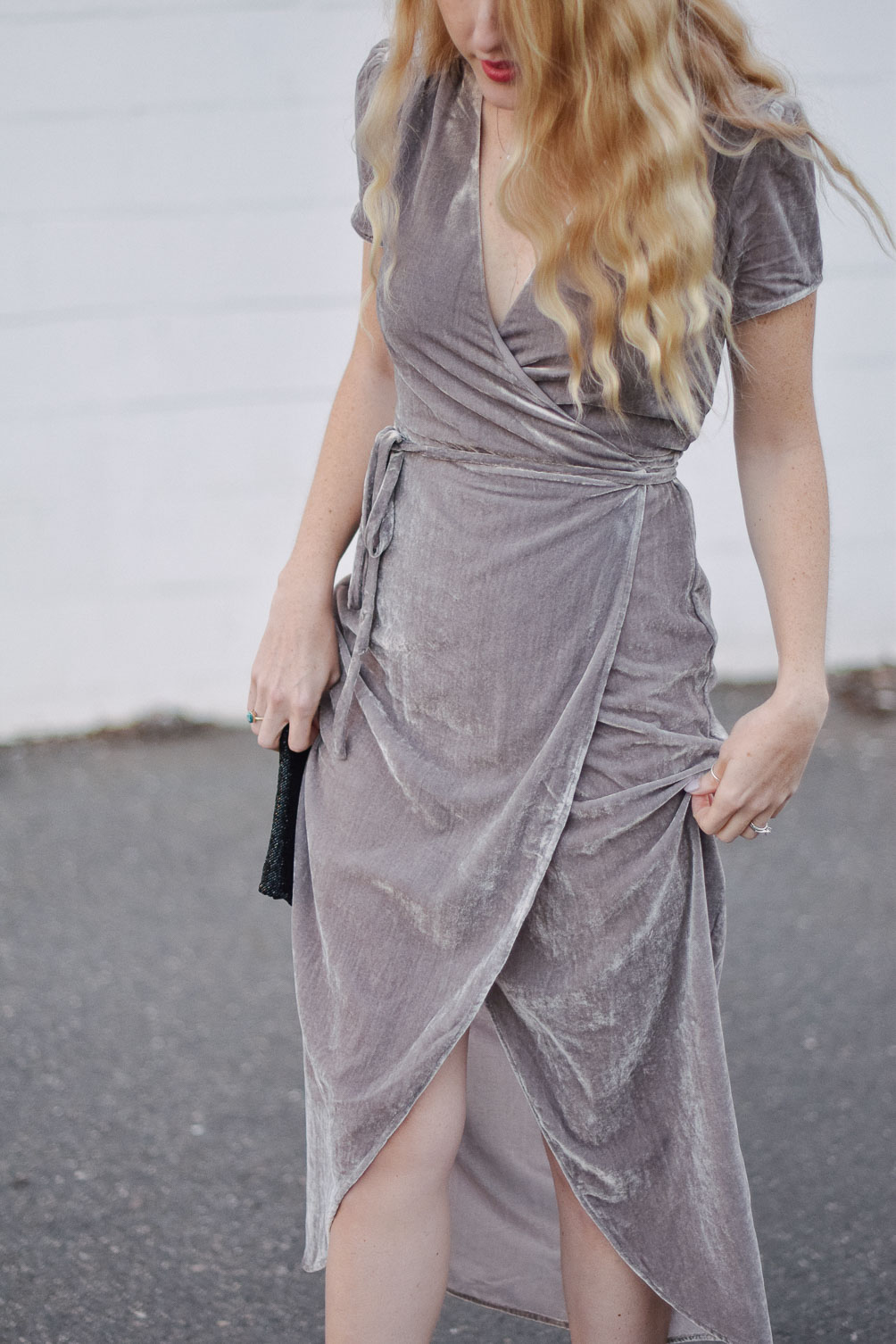 styling a metallic holiday dress party outfit with a beaded clutch