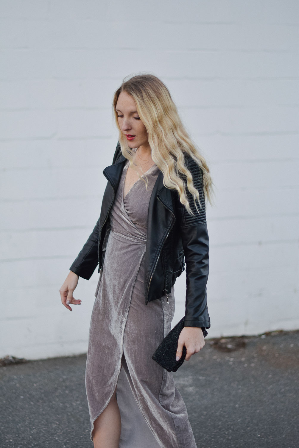 styling a metallic holiday dress party outfit with faux leather jacket and beaded clutch