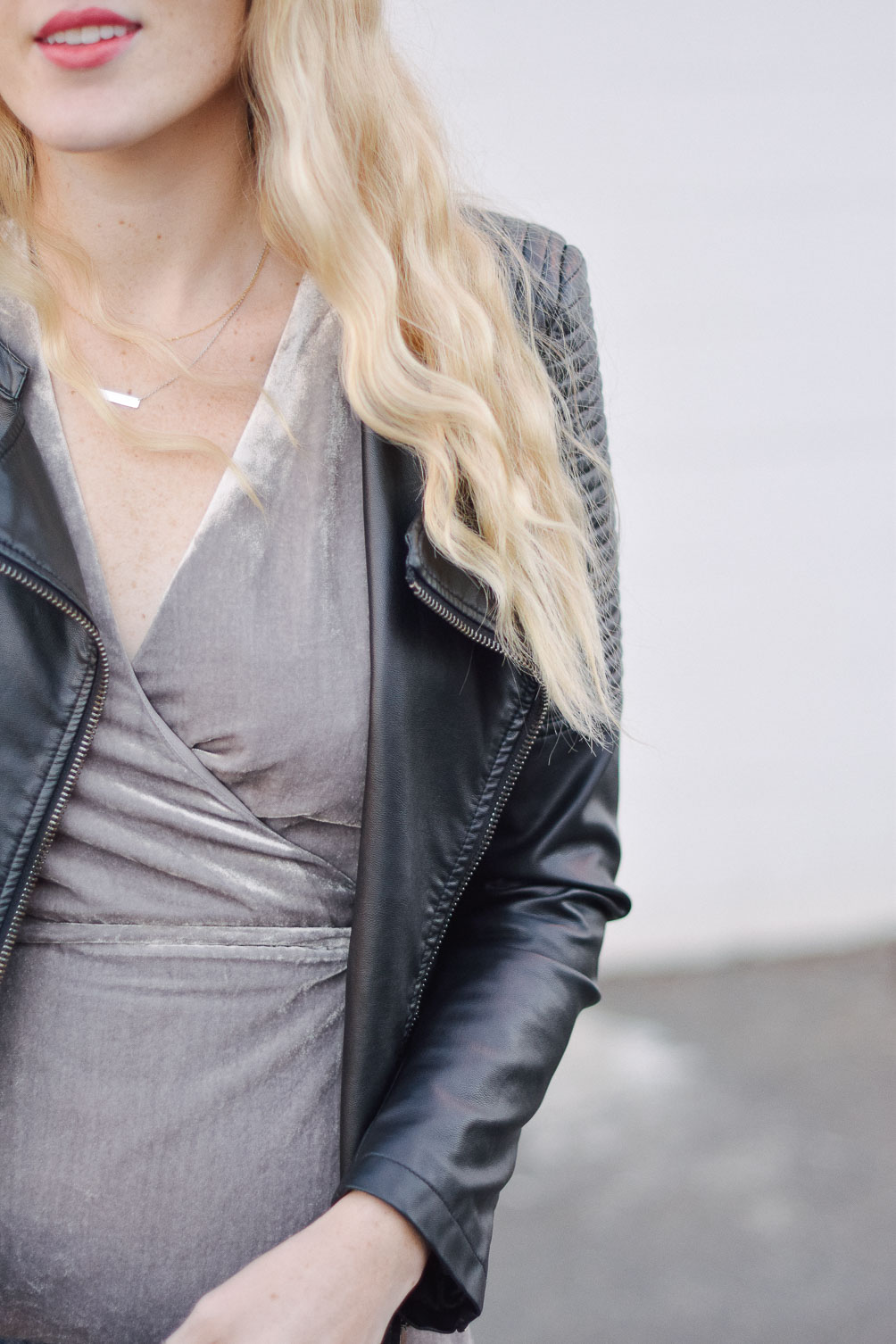 styling a metallic holiday dress party outfit with faux leather jacket