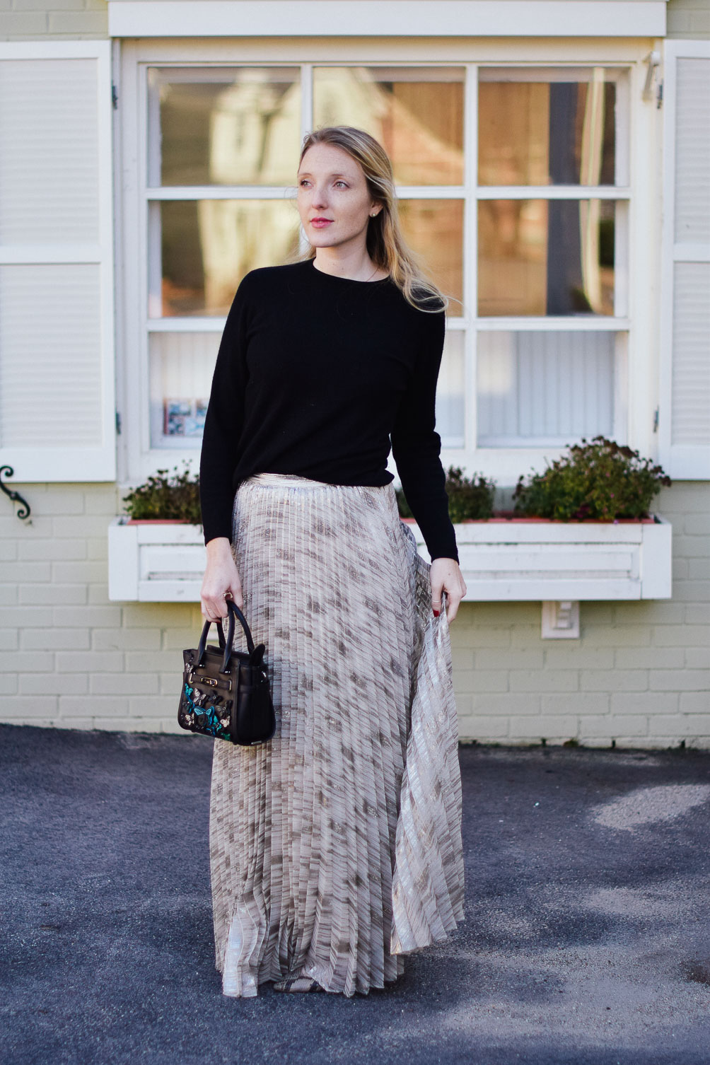 styling a metallic maxi skirt with snakeskin flats and cozy cashmere sweater
