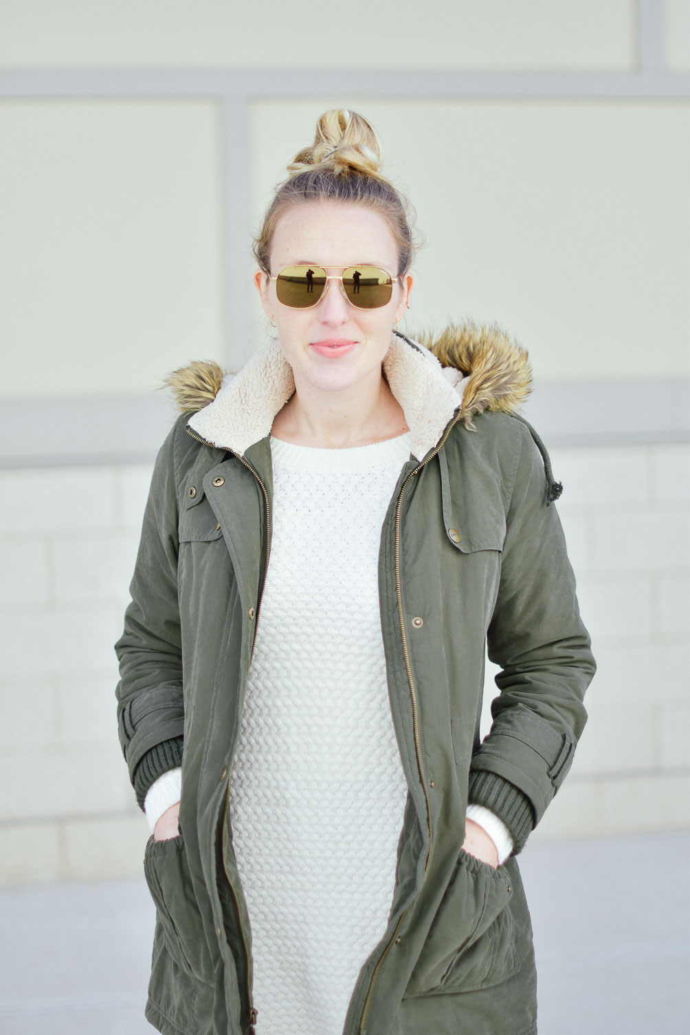 styling a green fur trim parka with this sweater dress over dark skinny jeans and olive suede sneakers