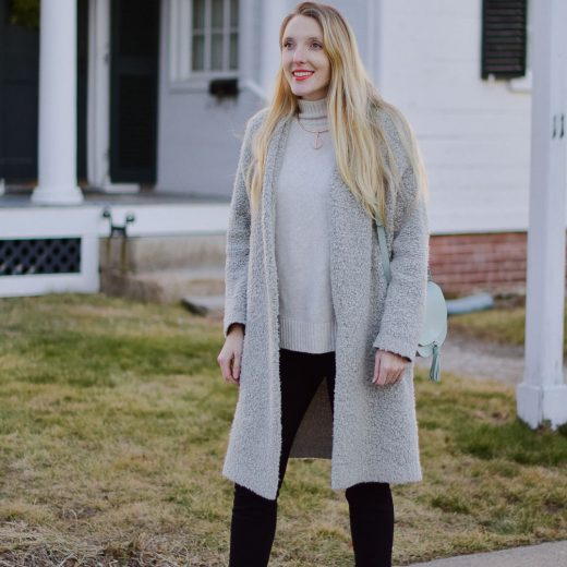 styling a coatigan layered over black skinny jeans and turtleneck sweater with black leather booties