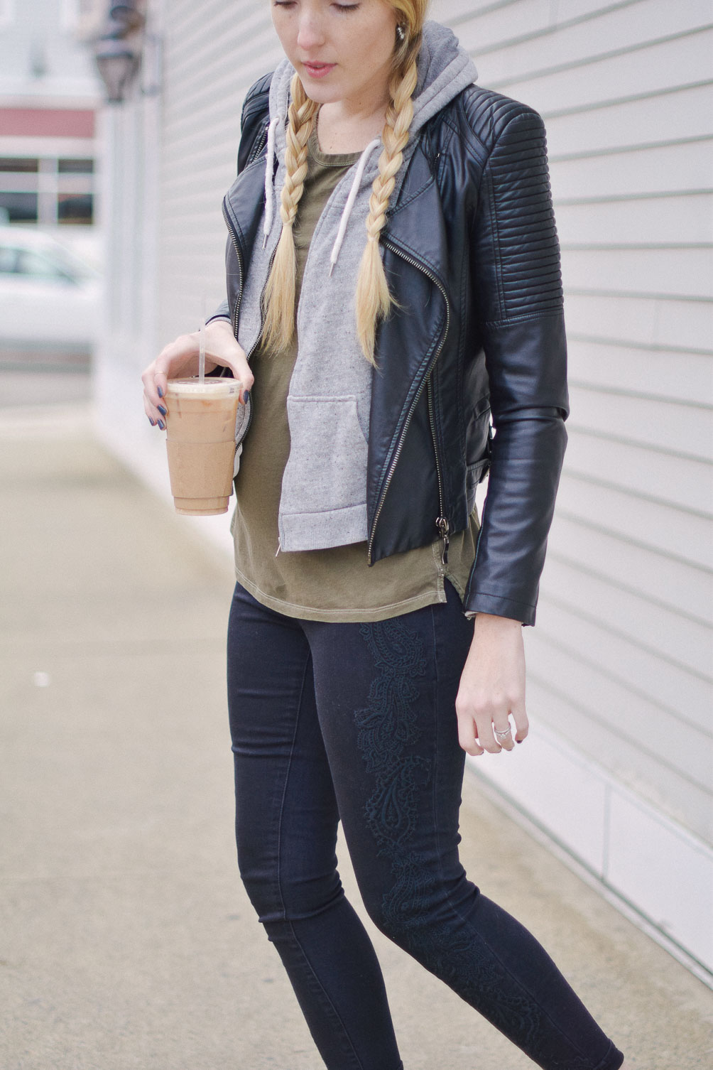 styling black embroidered denim with a vegan leather jacket and oxblood block heel loafers