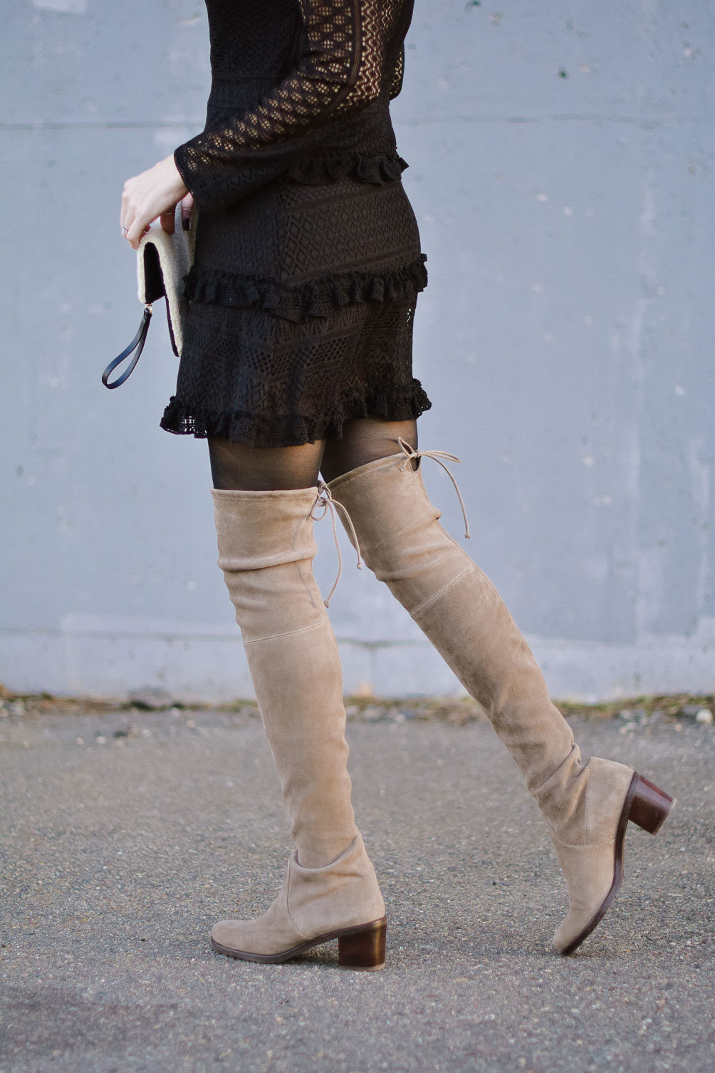 winter outfit inspiration with black lace ruffle dress and suede over the knee boots