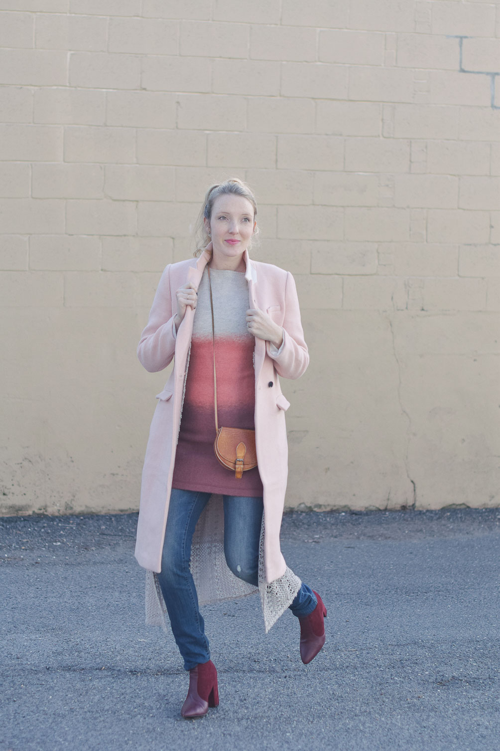 styling pink ombre layers for winter with a duster sweater, maternity jeans, and burgundy boots