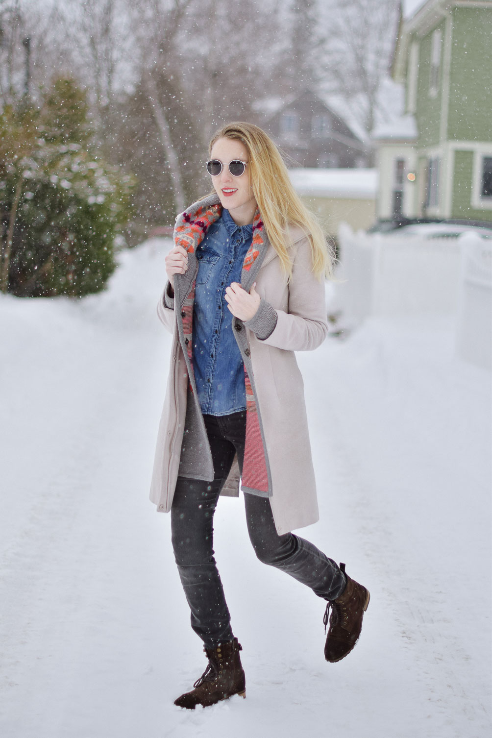 styling this cozy winter look with an aztec print sweater, chambray shirt, gray skinny jeans, and brown boots