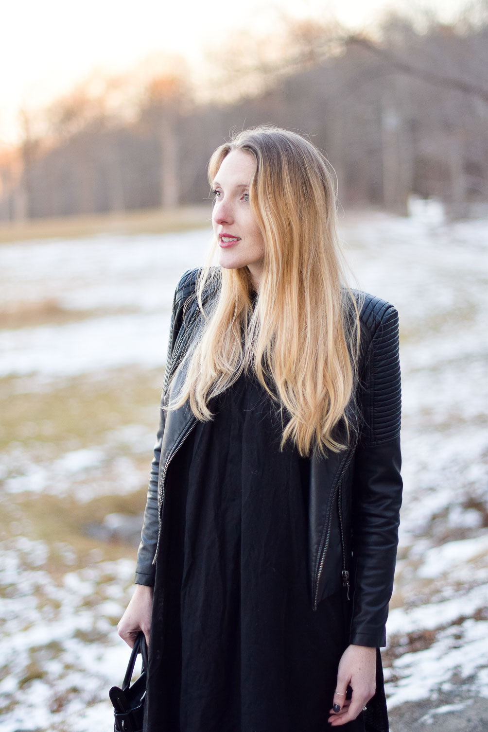 styling a black mumu dress with raw edge denim and vegan leather moto jacket