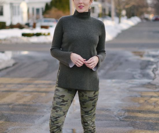 styling skinny camo pants with a cashmere turtleneck sweater and knee high boots
