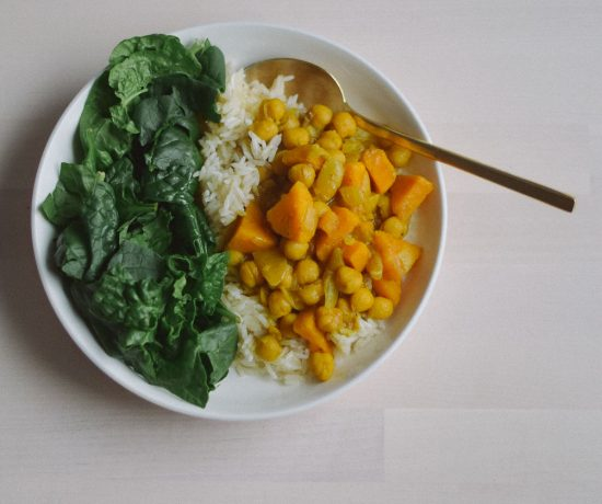 preparing an easy indian-inspired dinner recipe for sweet potato chickpea curry stew