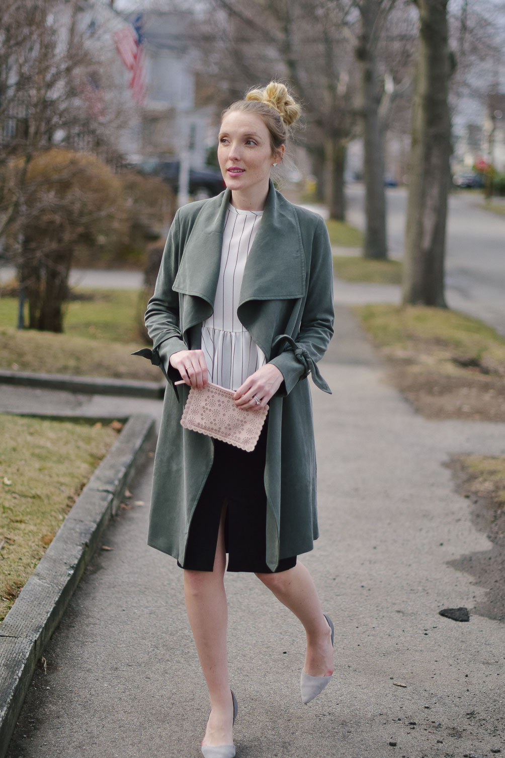 styling a feminine green trench coat for transitioning to spring with peplum details and a pencil skirt